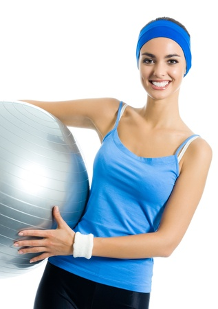 Young cheerful smiling woman with fitball, isolated over white background photo