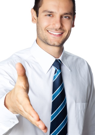 Happy smiling business man giving hand for handshake, isolated over white background photo