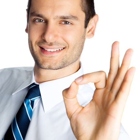 ok hand: Happy smiling cheerful business man with okay gesture, isolated over white background