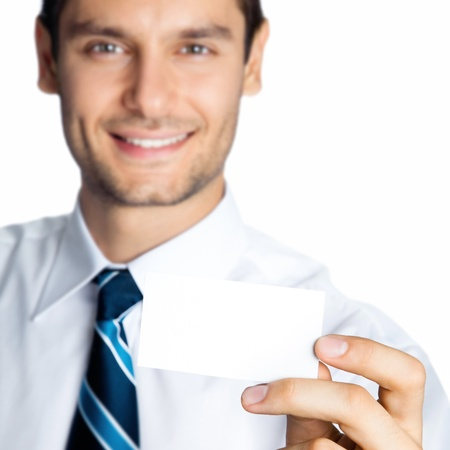 Happy smiling young business man showing blank business, plastic, credit card or signboard, isolated over white background Stock Photo - 17767487