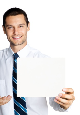 Happy smiling young business man showing blank signboard, isolated over white background photo