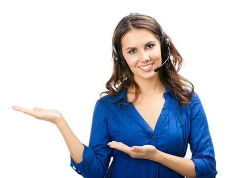 call center woman: Portrait of happy smiling cheerful young support phone operator in headset showing copyspace area or something, isolated over white background