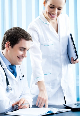 Two happy medical people working together at office Stock Photo - 17846392