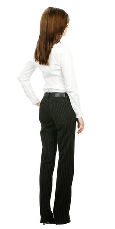 Full body of young business woman looking at something, from the back, isolated on white background photo