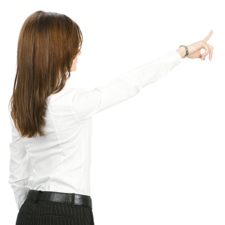 Young business woman pointing at something in her back, isolated over white background Stock Photo - 17792159