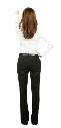 Full body of young business woman pointing at something in her back, isolated on white background Stock Photo - 17792156