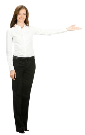 1 woman only: Full body portrait of happy smiling beautiful young cheerful business woman showing something, isolated on white background
