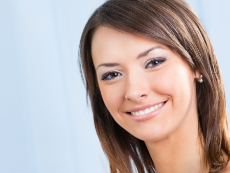 Close up portrait of beautiful smiling young woman Stock Photo - 17888238
