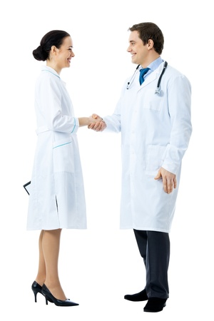 Full body portrait of two medical people handshaking, isolated on white background photo