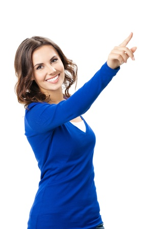woman pointing up: Happy smiling beautiful young woman showing forward to copyspace, visual imaginary or something, or pressing virual button isolated over white background
