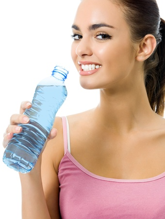 Young happy smiling woman in sportswear drinking water, isolated over white background photo
