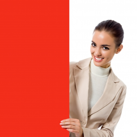 Happy young business woman showing blank red signboard, isolated over white background photo