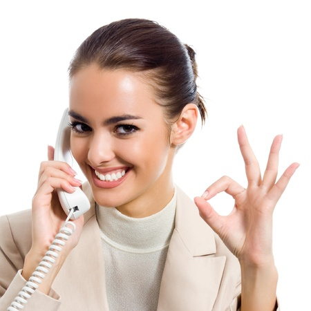 Business woman with phone showing thumbs up sign, isolated over white background photo