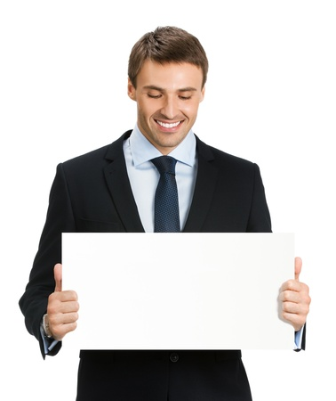 a placard: Happy smiling young business man showing blank signboard, isolated over white background