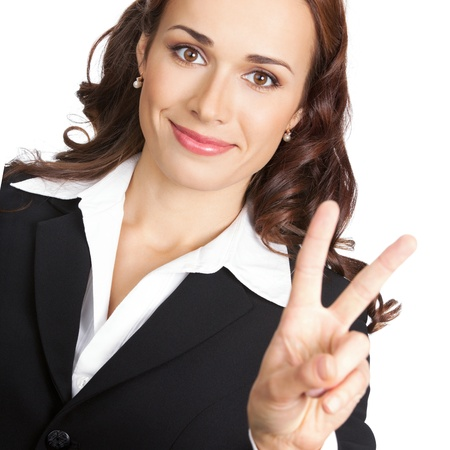 Happy business woman showing two fingers or victory gesture, isolated over white background photo