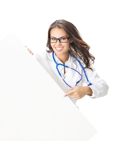 Portrait of happy smiling young female doctor showing blank signboard, isolated over white background Stock Photo - 18547689