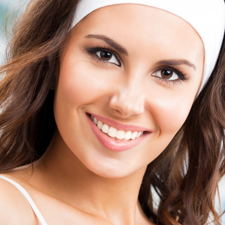 Portrait of young cheerful smiling woman at fitness club or gym photo