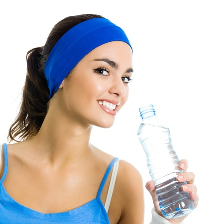 water beautiful: Portrait of cheerful young attractive woman in fitness wear drinking water, isolated over white background Stock Photo