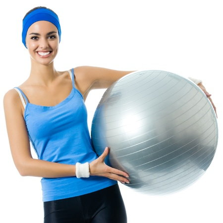 Young cheerful smiling woman with fitball, isolated over white background Stock Photo - 18658615