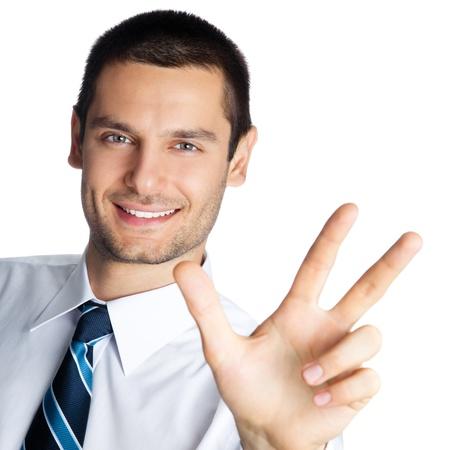 Portrait d'homme d'affaires sourire heureux montrant trois doigts, isol? sur fond blanc