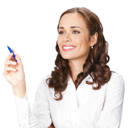 Happy smiling cheerful beautiful young business woman writing or drawing on screen with blue marker, isolated over white background photo