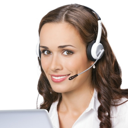 Portrait of happy smiling cheerful beautiful young support phone operator in headset with laptop, isolated over white background