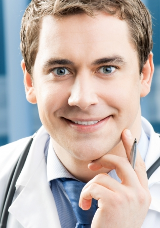 Happy smiling young doctor at office Stock Photo - 18917568