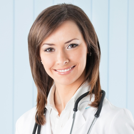 Portrait of cheerful female doctor at office photo