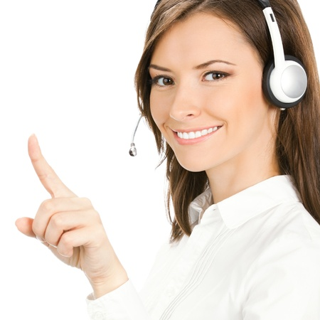 Portrait of happy smiling cheerful customer support phone operator in headset pointing at something, isolated over white background photo