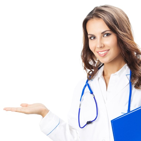 Portrait of happy smiling young female doctor showing something or blank area for text, or copyspace, isolated over white background photo