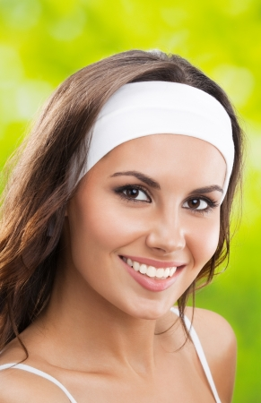individual sport: Portrait of happy smiling young beautiful woman in fitness wear Stock Photo