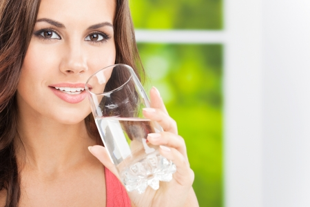 girl drinking water: Portrait of young woman drinking water, outdoor, with copyspace Stock Photo