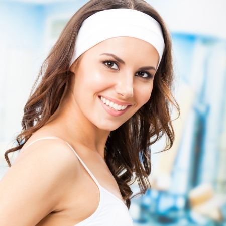 individual sport: Portrait of young cheerful smiling woman at fitness club or gym