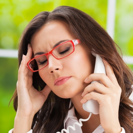 Thinking, tired or ill with headache business woman with phone at office Stock Photo - 20406190