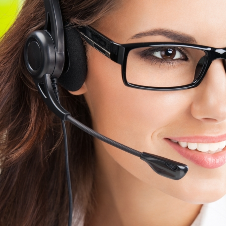 phone operator: Portrait of happy smiling cheerful beautiful young support phone operator in headset