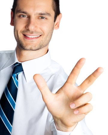 only three people: Portrait of happy smiling businessman showing three fingers, isolated over white background