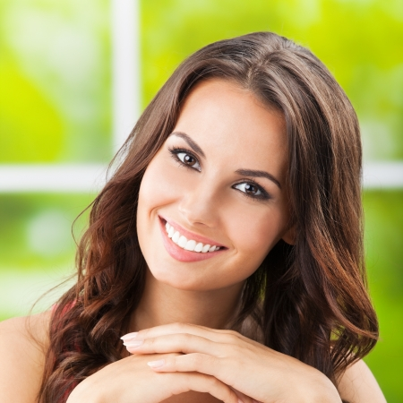 dental smile: Portrait of beautiful young happy smiling woman, outdoors