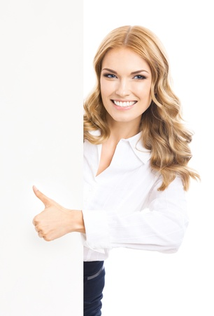 Happy smiling young business woman showing blank signboard and thumbs up gesture, isolated over white background photo