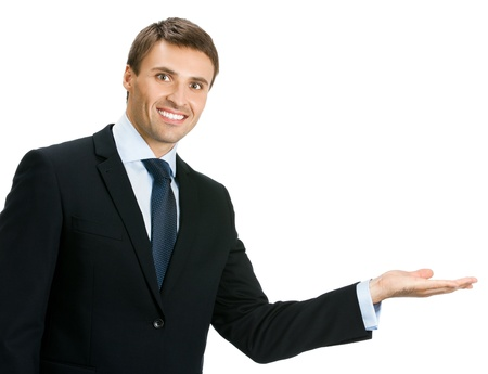 copyspase: Happy smiling young business man showing blank area for sign or copyspase, isolated over white background