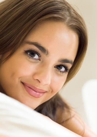 Young beautiful happy smiling woman waking up on bed  photo