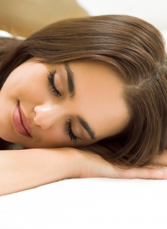lazyness: Young beautiful woman sleeping on bed