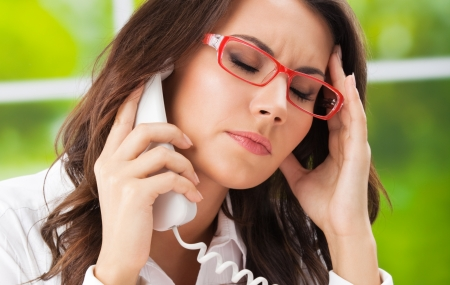 Thinking, tired or ill with headache business woman with phone at office Stock Photo - 21539377
