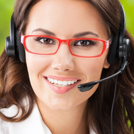 internet sale: Portrait of happy smiling cheerful beautiful young support phone operator in headset, at office