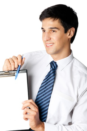 Happy smiling young business man showing blank clipboard, isolated on white background photo