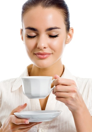 one eye closed: Young happy woman with cup of coffee, isolated over white background
