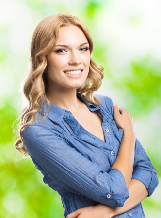 long blonde hair: Portrait of beautiful young happy smiling blond woman with long hair, outdoors