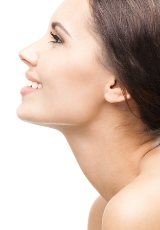 face side: Profile side portrait of beautiful young happy smiling woman, isolated over white background