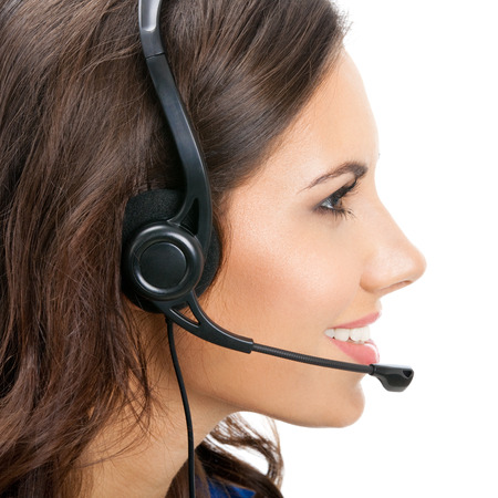 Portrait of happy smiling cheerful beautiful young support phone operator in headset photo