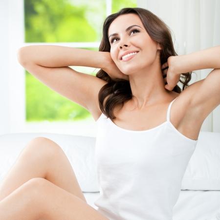 waking up: Young beautiful woman waking up Stock Photo