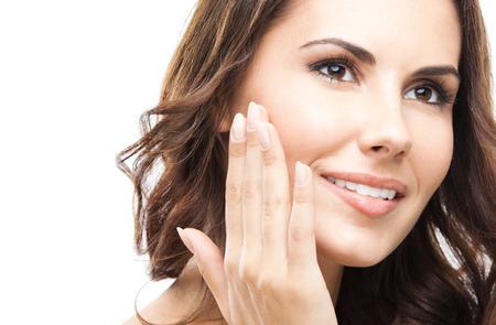 Portrait of freudig lächelnd schöne junge Frau zu berühren Haut oder die Anwendung der Creme Standard-Bild - 22644948